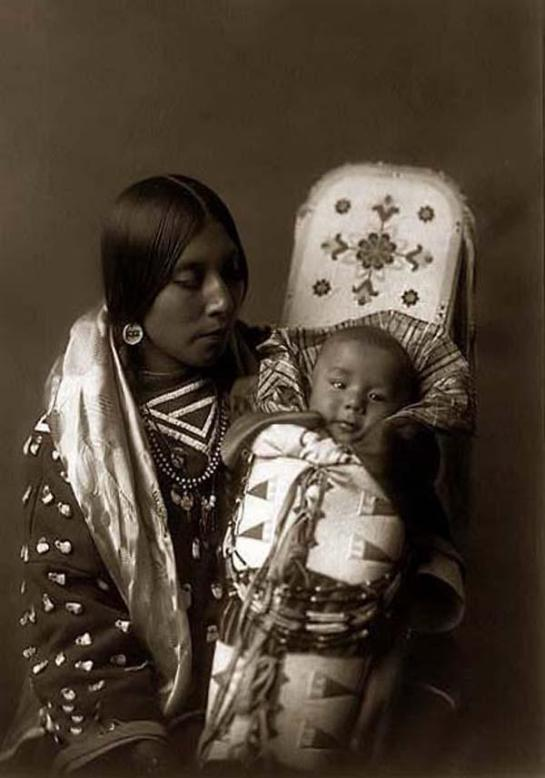 Indian Mother holding her Child. It was taken in 1908