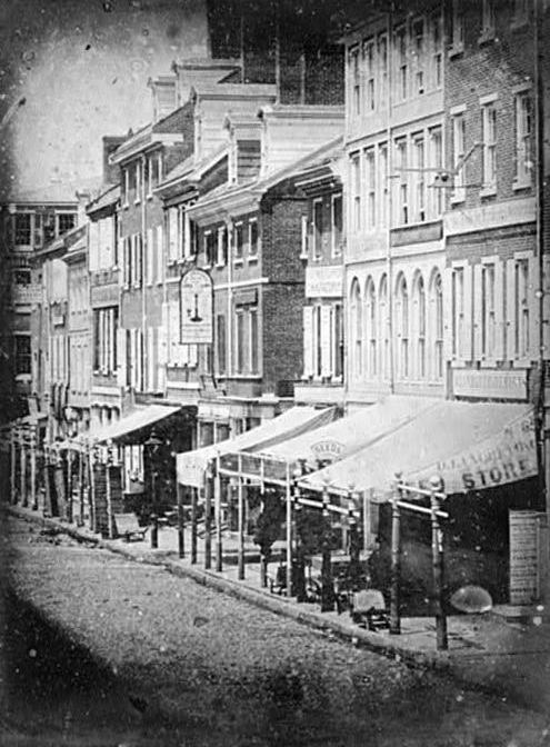 North side of Chestnut Street, between Second Street and Third Street, Philadelphia, Pennsylvania. It was taken in 1842