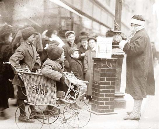 Santa Claus and Children on the streets of New York City circa 1900.