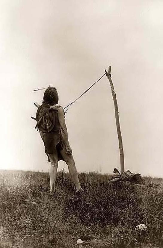 Sund Dance Ritual Indian Ceremony in which a man is suspended by leather straps attached to sticks in his chest. It was created in 1908