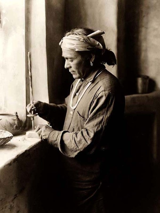 Zuni Bead Worker Drilling Holes. It was created in 1903