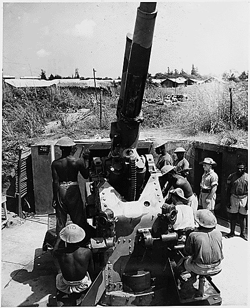 British soldiers teach African natives how to operate a 3.7cm anti-aircraft gun