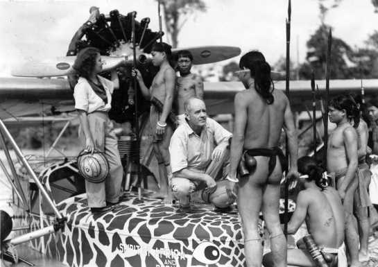 "Explorers Martin and Osa Johnson with their craft ""The Spirit of Africa and Borneo"" confront Marut tribesmen while on Safari, circa 1935."