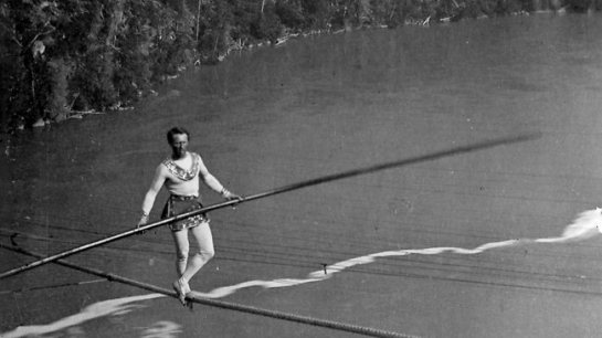 French tightrope walker Jean Francois Gravelet crossing the Niagra Falls in the 1800s.