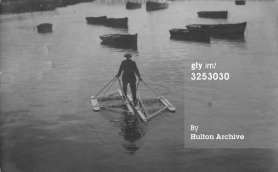 circa 1920 A man in the Channel using a floating contraption that allows him to walk on the water