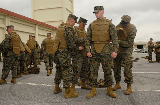 Marines with Security Company, Combat Logistics Battalion 4, Combat Logistics Regiment 3, 3rd Marine Logistics Group, adjust Lance Cpl. Andrew Best's Modular Tactical Vest