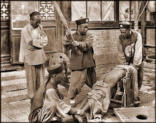 Chinese punishment, whipping a lawbreaker [c1900]