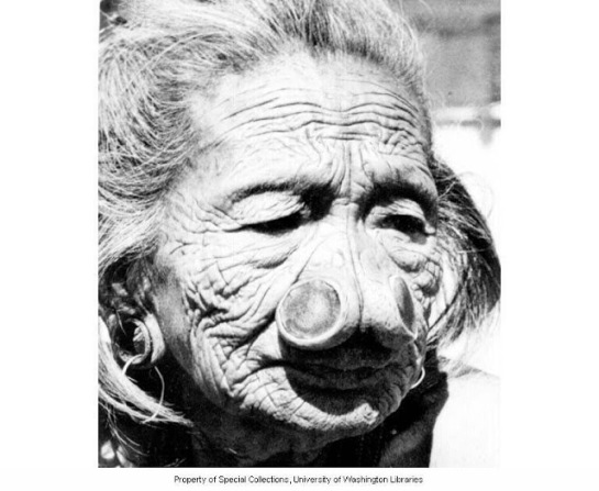 109 year old Apatani woman of slave class with nose plugs, Subansiri Frontier District, India, ca. 1954
