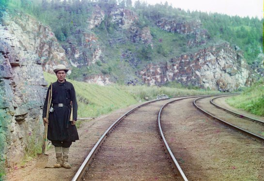 A switch operator poses on the Trans-Siberian Railroad, near the town of Ust Katav on the Yuryuzan River in 1910