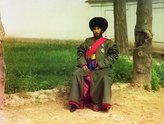 Isfandiyar Jurji Bahadur, Khan of the Russian protectorate of Khorezm (Khiva, now a part of modern Uzbekistan), full-length portrait, seated outdoors, ca. 1910